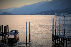 Lake Como, Italy, 09.28.2016. A motor boat under a sunset on the Lake Como, near Bellagio, Italy. Stock Images