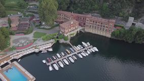 LAKE COMO, ITALY Villa Desta from the drone and the Italian Alps in background. LAKE COMO, ITALY Villa Desta from a boat with the town of Varenna and the Italian stock footage