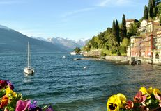 Lake Como and lakefront of Varenna in a beautiful spring day. Royalty Free Stock Photos
