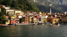 Lake Como, Varenna – Italy. Varenna village as seen by sea. Varenna is the port to take the ferry to Bellagio stock video footage
