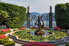 Lake Como, Villa Carlotta. Magnificent park with fountains, statues, flower beds Royalty Free Stock Photography