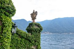 Lake Como from Villa del Balbianello view. Mountains and cloudy sky. Lenno, Italy royalty free stock photo