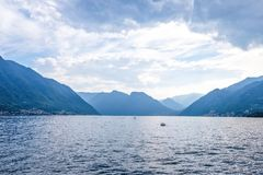 Lake Como from Villa del Balbianello view. Mountains and cloudy sky. Lenno, Italy stock images