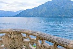 Lake Como from Villa del Balbianello view. Mountains and cloudy sky. Lenno, Italy royalty free stock photos