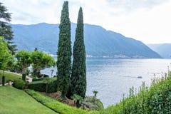 Lake Como from Villa del Balbianello view. Mountains and cloudy sky. Lenno, Italy stock image