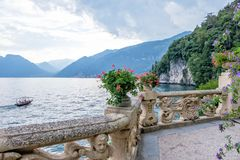Lake Como from Villa del Balbianello view. Mountains and cloudy sky. Lenno, Italy stock photo