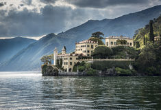Lake Como Villa. The old Villa del Balbianello viewed from a ferry boat on Lake Como near Lecco, Italy royalty free stock photo