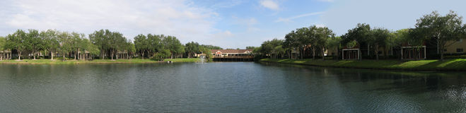 Lake in condo community. In Florida; houses on right of photo partly hidden by shadows Stock Images