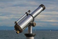 Lake Constance binoculars. Silver binoculars in front of Lake Constance Stock Image