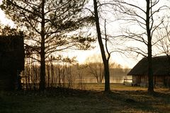 Lake cottage. Cottage by lake at sunset Royalty Free Stock Photography