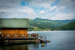 Mountain lake cottage Royalty Free Stock Image