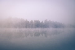 Lake covered by fog Stock Images