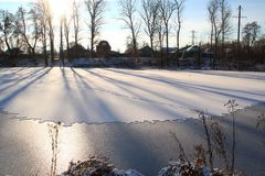 The lake is covered with ice. Royalty Free Stock Photo