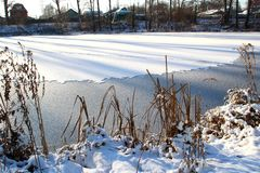 The lake is covered with ice. Stock Images