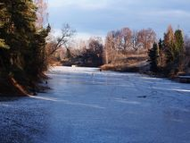 The lake is covered with ice. Sunny weather. Details and close-up. royalty free stock photo