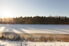Lake covered with snow Stock Photos
