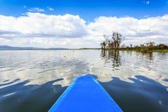 Lake cruise by blue canoe, Naivasha, Kenya Stock Photo