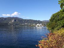 Lake D`orta in autumn days. Piemonte, italy - 12/05/2018: Amazing trip in Piemonte with an incredible view to the lake D`orta in autumn days and a caption of stock images