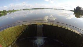Lake dam with water splash in summer time. Timelapse 4k stock footage
