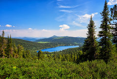 Lake in dark coniferous taiga. Nature Park Ergaki. Lake Bright in dark coniferous taiga. Nature Park Ergaki. Krasnoyarsk region. Russia Stock Photos