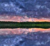 Lake dark sunset reflection Royalty Free Stock Photos