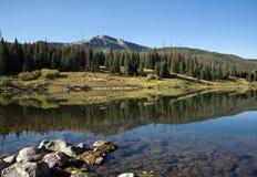 Lake at Dawn. The water of a high mountain lake is still at dawn Royalty Free Stock Photos