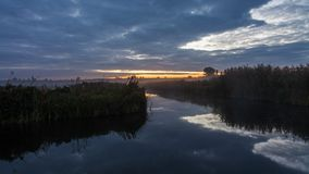 Lake in spring at dawn. Reflection of clouds in water stock footage