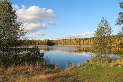 Lake in a delightful autumn forest at sunny day. Russia. royalty free stock images