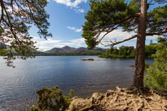 Lake Derwent Water and cruise boat view from its shoreline, Kesw Royalty Free Stock Photos
