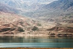 Lake in desert mountains, Kazakhstan Stock Photos