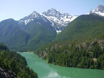 Lake Diablo. Glacial silt gives the bright green appearance to Lake Diablo in the Northern Cascades National Park in Washington State stock photos