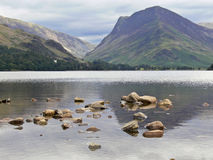 Lake district 1. Scenic view of mountains with rocky lake in foreground, Lake District, Great Britain Stock Photos