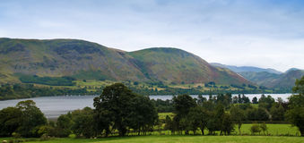 Lake District. View over Ullswater, Lake District, Cumbria, UK. Arthur's Pike and Bonscale Pike in distance with early morning mist lingering Stock Image
