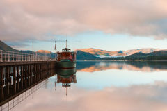 Lake District. Scenic view of boats moored by wooden pier , Lake District National Park, England Royalty Free Stock Images