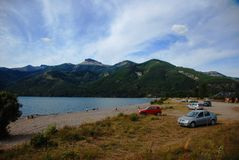 Lake district in Argentina. People and cars on a lake shore in Patagonia, Argentina Stock Photography