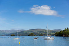 Lake District boats and mountains Windermere Cumbria England UK Royalty Free Stock Images