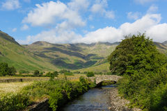 Lake District country scene mountains and river summer day Langdale Valley Mickleden Beck river Cumbria England royalty free stock images