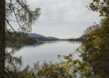 Lake District, England, the UK - bleak autumnal day. This image shows a view of a lake in Cumbria, Lake District, the UK. It was taken on a cloudy day in stock photo