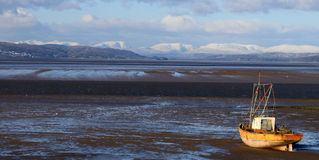 Lake District Hills seen from Morecambe in winter. Stock Photo