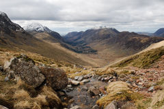 Lake district Landscape Assent of Great Gable. Lake district landscape view of snow-capped peaks with stream and rocks during an assent of Great Gable Royalty Free Stock Photo