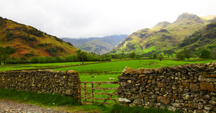 Lake District landscape. Scenic landscape of Lake District with dry stone wall in foreground, Cumbria, England Stock Images