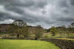 Lake District landscape with stormy sky over countryside anf fie Royalty Free Stock Photos