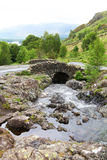 Lake District National Park. Scenic view of old arched stone bridge over river in Lake District National Park, Cumbria, England Stock Photo