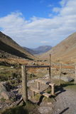 Lake District view. A view of the Lake District over a stile and down a valley royalty free stock images