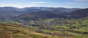 Lake district view of Ambleside. And surrounding mountains. Cumbria. Blue Sky Royalty Free Stock Photography