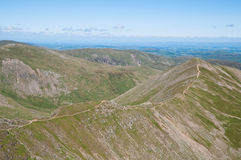 Lake District, View from Helvellyn. Landscape of the Lake District National Park from the top of Helvellyn - paths through the mountains Stock Photos