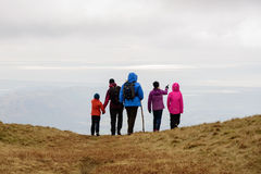Lake District view over Irish Sea. Young and old hikers looking over the Irish Sea from hill top in the Lake District, England royalty free stock photography