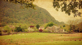 Lake District. Village in Lake District, Cumbria. UK.  Photo in retro style. Added paper texture Royalty Free Stock Photo