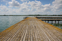 Lake dock. With cloudy skies Royalty Free Stock Photo