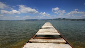 Lake dock. With nice cloudy sky Royalty Free Stock Photography